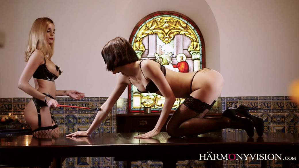 Lesbian Debauchery. Erica Fontes and Arian nude, wearing black stockings, in a Lezdom Fetish video from Harmony Vision.