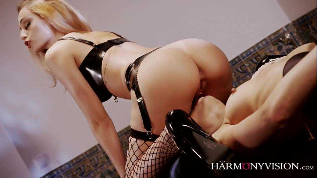 Erica Fontes and Arian nude, wearing black stockings, in a Lezdom Fetish video from Harmony Vision.