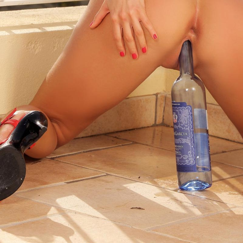 A nude girl masturbating with a wine bottle. From a gallery at infocusgirls.