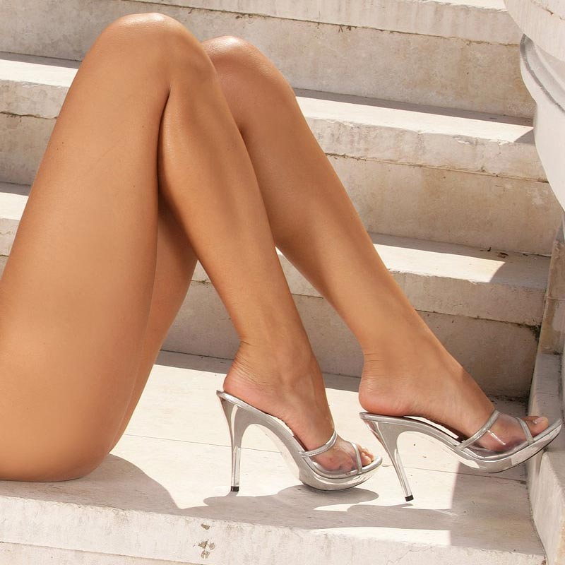 A nude girl wearing high heels on a staircase. from a gallery at infocusgirls.