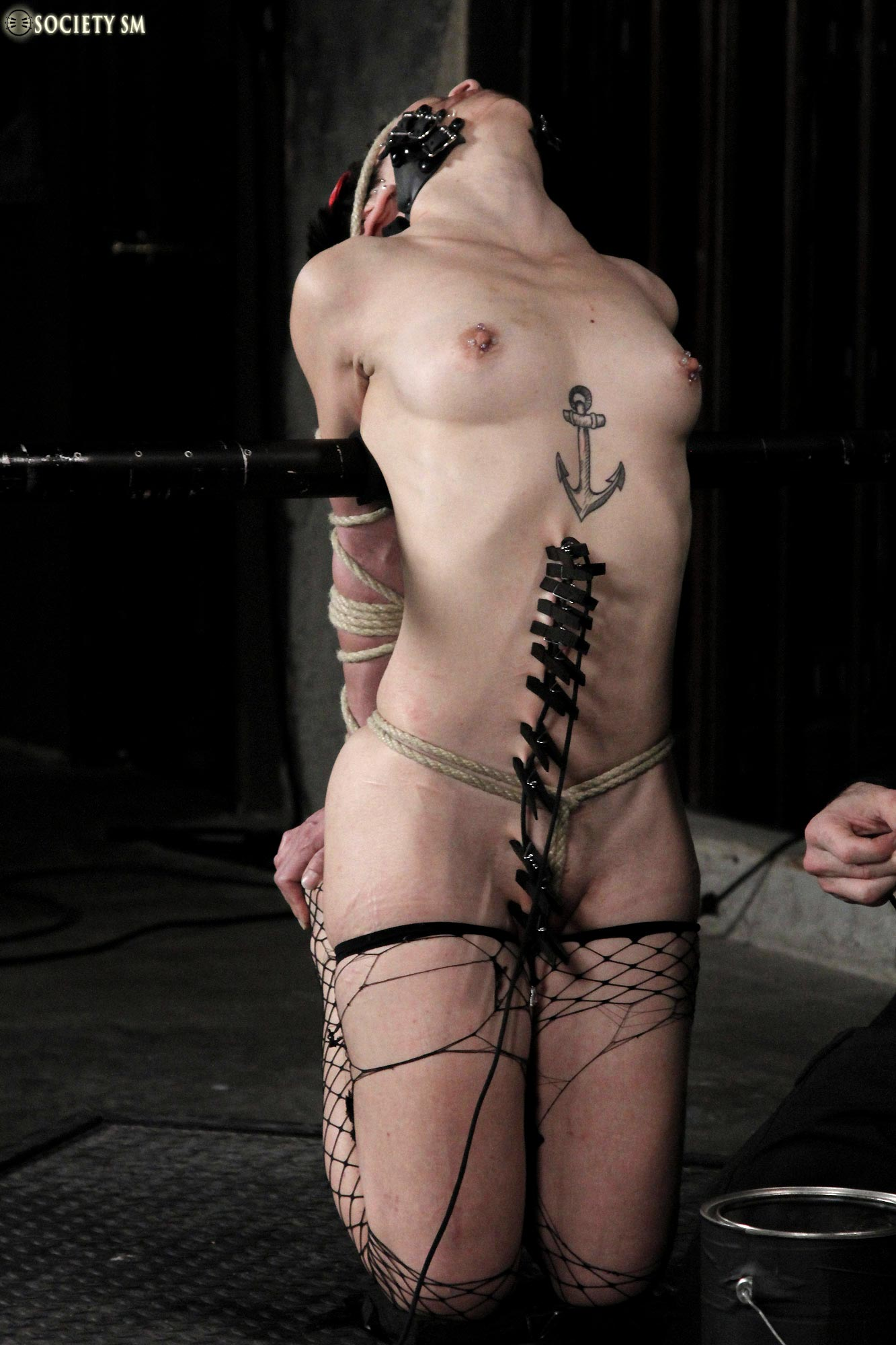 Mei Mara, nude, bound, blindfolded and tortured in a Bondage SM video from Society SM.
