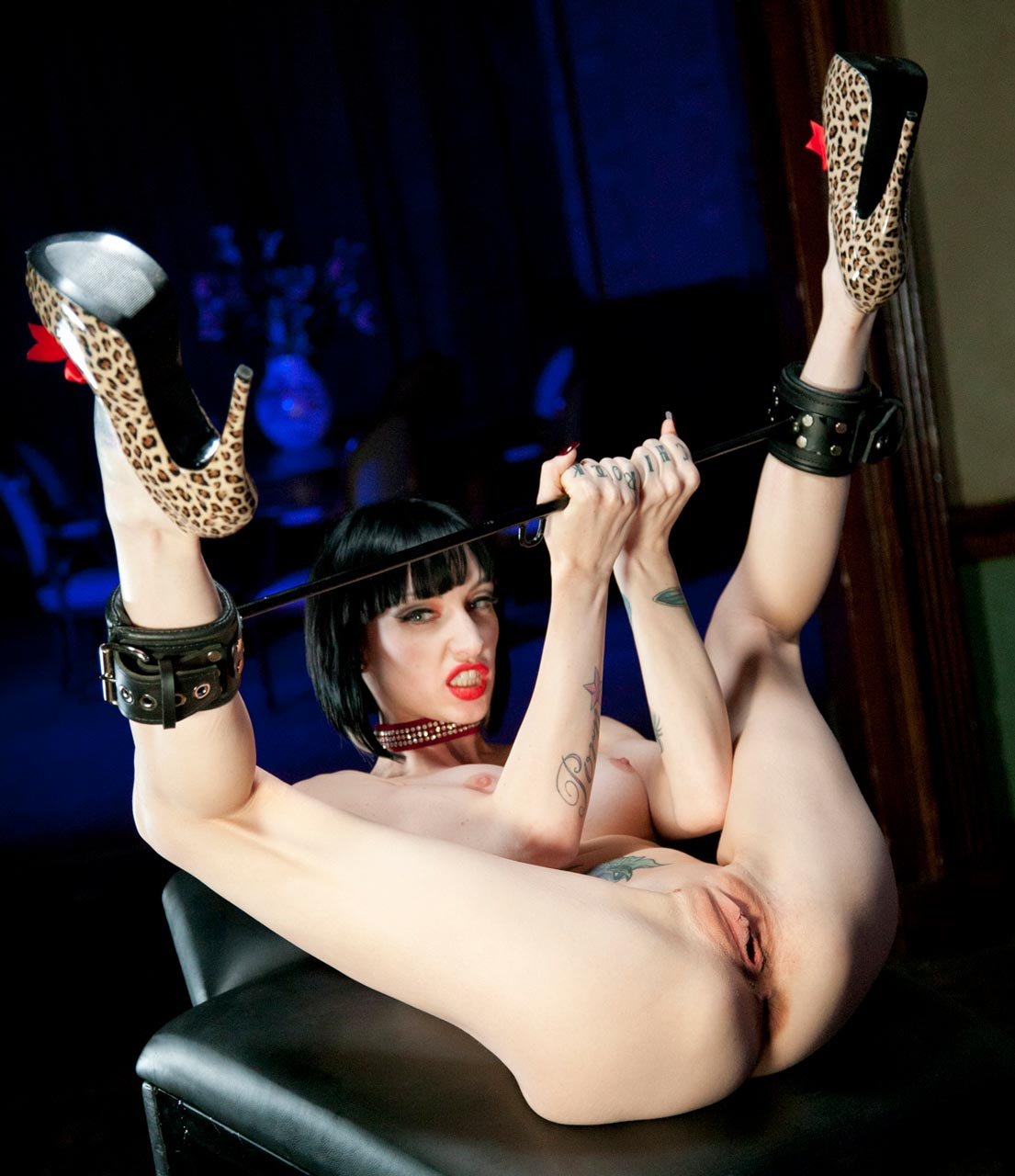 Sofia Valentine, spreads her shaved pussy while wearing High Heels in a BDSM Fetish video from Harmony Vision.