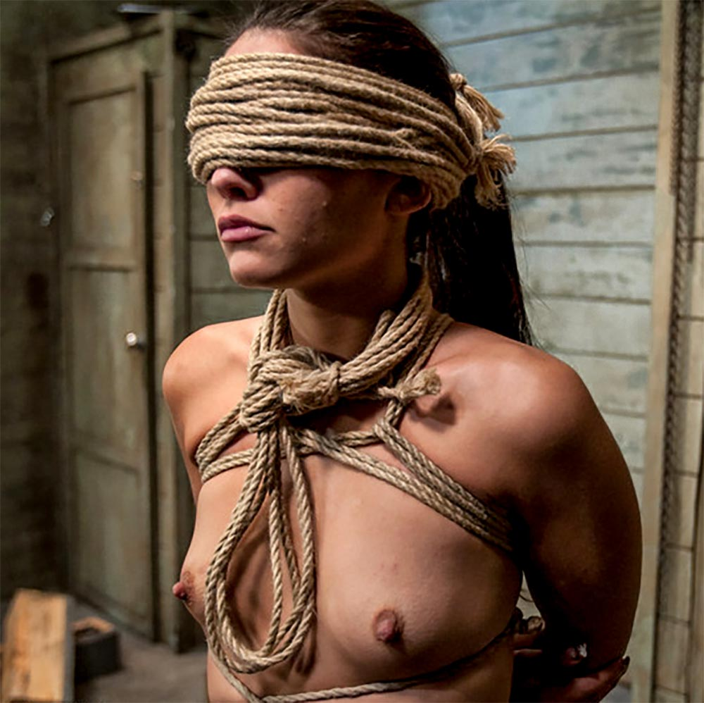 Blindfolded nude girl in a BDSM Bondage sex video. Jade Indica with a blindfold made by by rope.