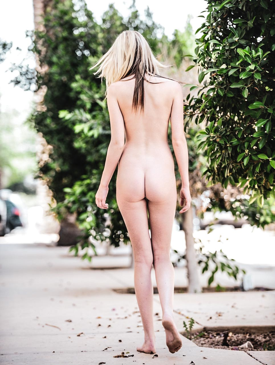 Nude girl walking in the street flashing her shaved pussy in public. Kiley for FTVGirls.