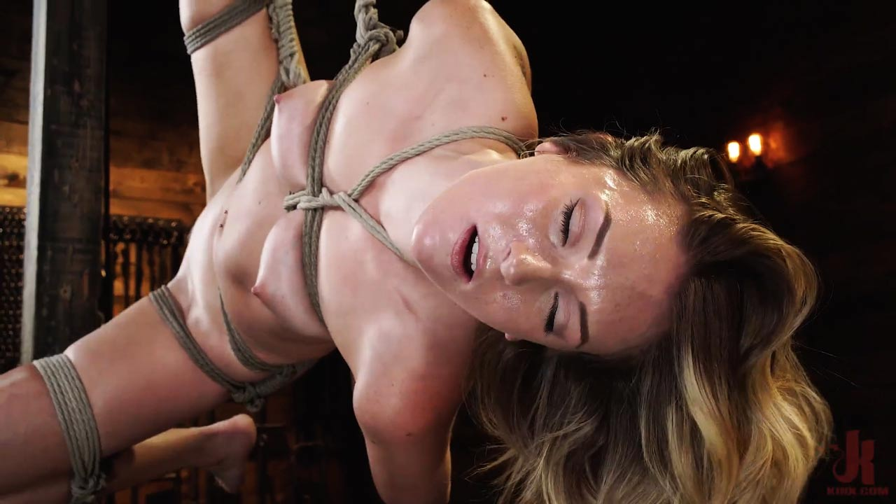 Charlotte Sins BDSM debut. The nude girl is bound in Bondage, flogged, caned and forced to orgasm at Hogtied. A Kink Domination video.