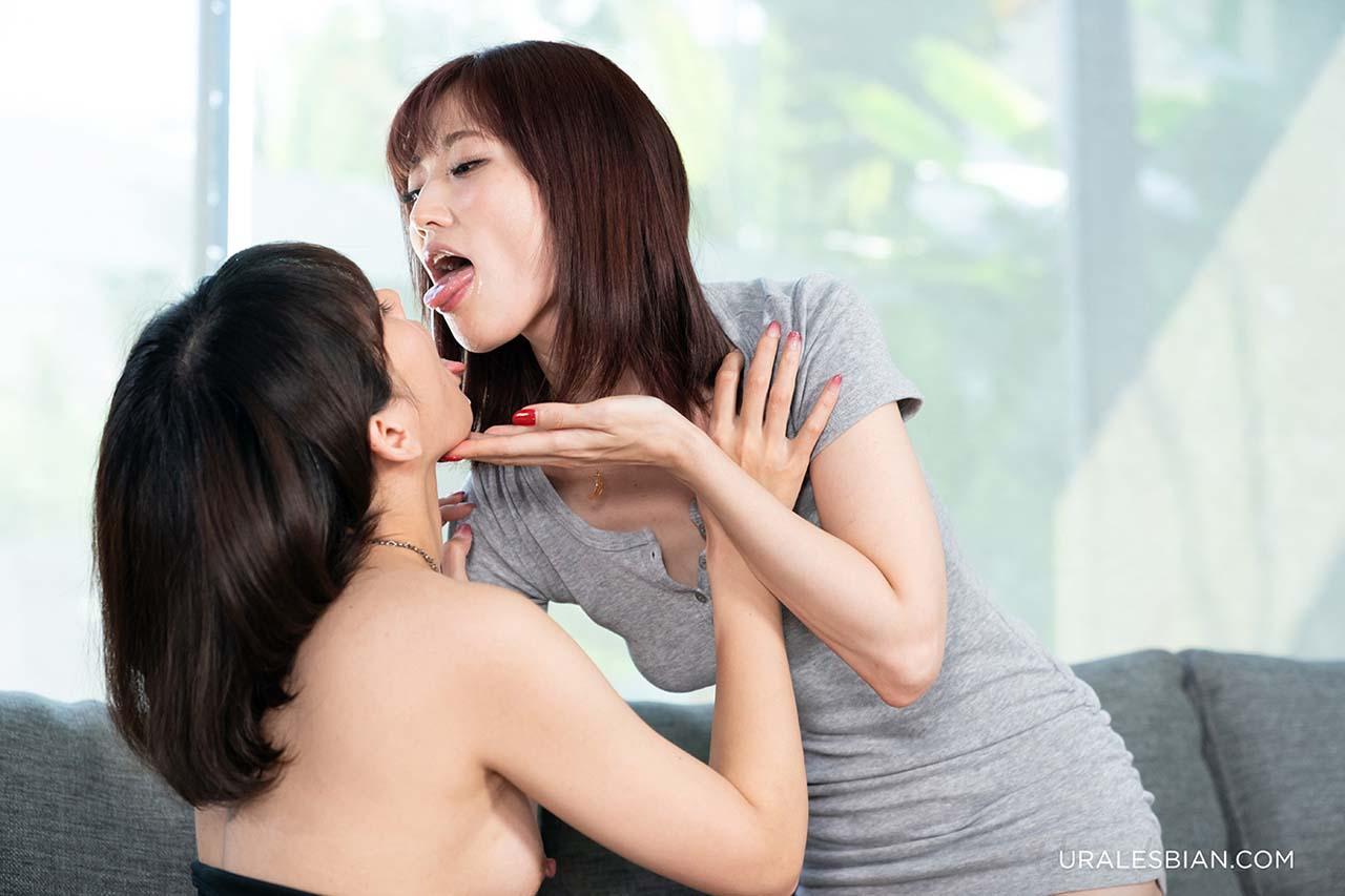 kissing girls in an uncensored lesbian sex video from UraLesbian.