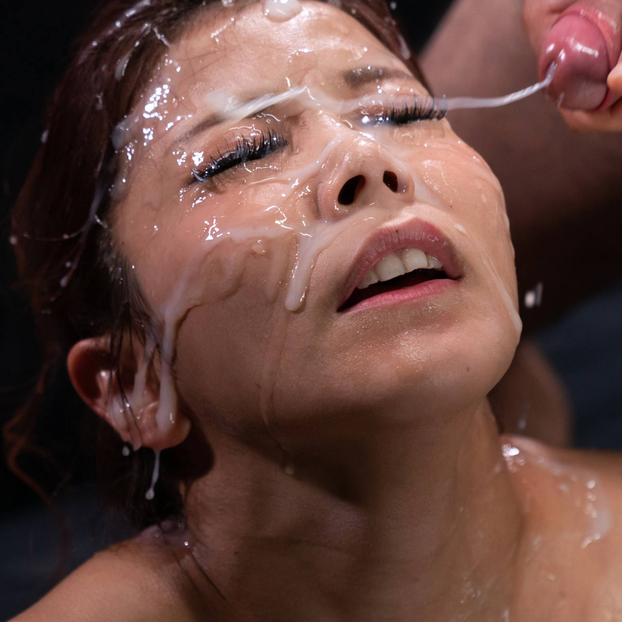 Saki Kawanami nude in a Bukkake Facial Cumshot Fetish video from SpermMania. A nude Japanese girl receives 18 facials while fucking and masturbating.